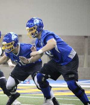 Evan Greeneway (right) has emerged as a capable blocker in his first full year as SDSU's starting left tackle