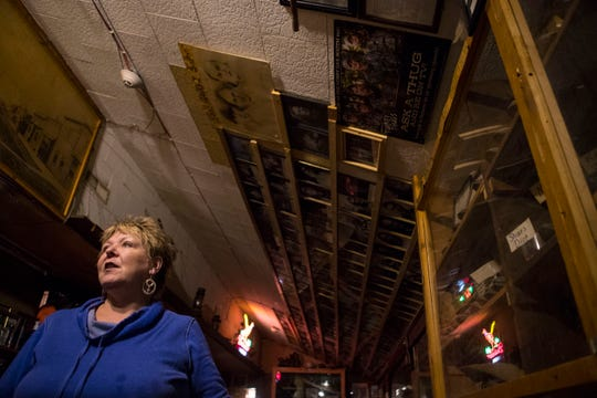 Shelly Day, owner of Frank Day's Bar and Restaurant in Dallas, talks about the many cowboy boots, framed photos of visitors and artifacts that line the walls of the bar, Sept. 26, 2018.