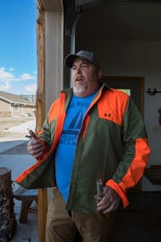 Judd Baker talks about hunting pheasant after a day's hunt at Biggins Hunting Lodge, Sept. 25, 2018. Baker, who lives in Texas and works in construction industry, treats top customers to a hunting trip to strengthen relationships.