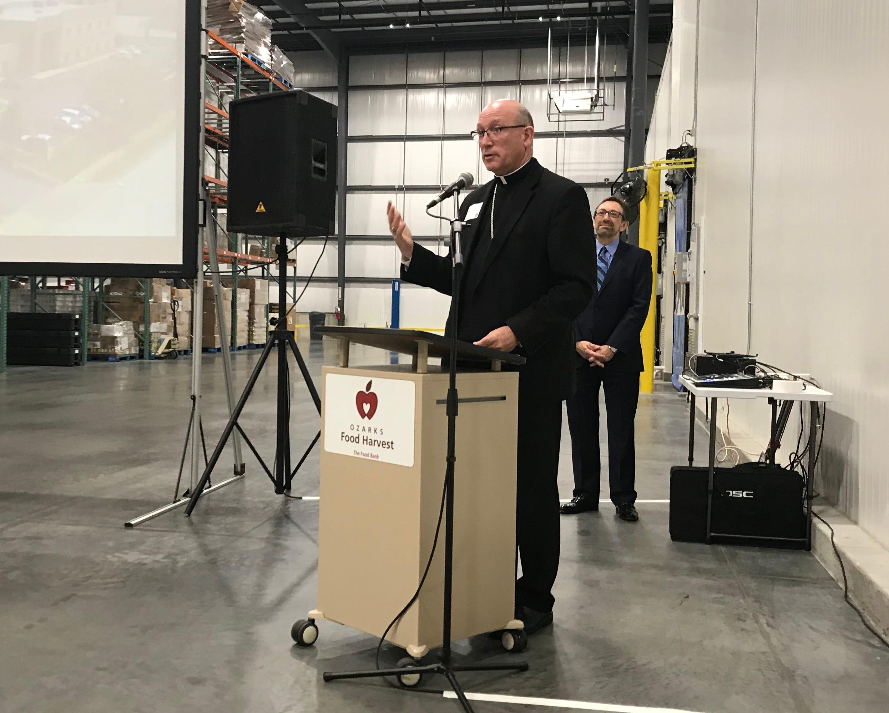 Bishop Edward M. Rice blessed Ozarks Food Harvest's distribution center expansion Thursday.