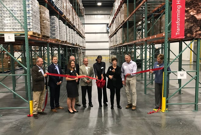 Rosalie O'Reilly Wooten cuts the ribbon at Ozarks Food Harvest new 56,000 square-foot distribution center expansion.