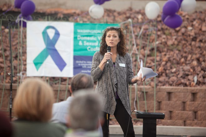 Dove Center Executive Director Lindsey Boyer speaks at the Shine a Light on Domestic Violence candlelight vigil at DSU Oct. 10, 2018.