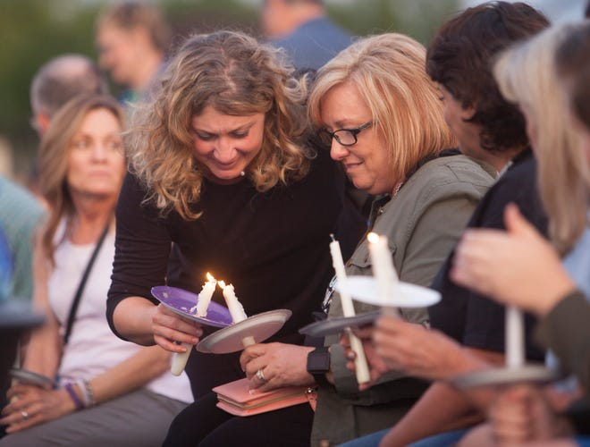Members of the community gather for the Shine a Light on Domestic Violence candlelight vigil at DSU Oct. 10, 2018.