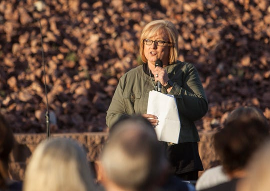 Debbie Heisler, from the Blue Butterfly House, speaks at the Shine a Light on Domestic Violence candlelight vigil at DSU Oct. 10, 2018.