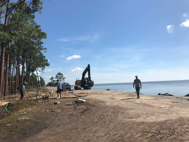 Work is underway to clear U.S. 98, a vital artery to beach communities along the Panhandle and Big Bend.