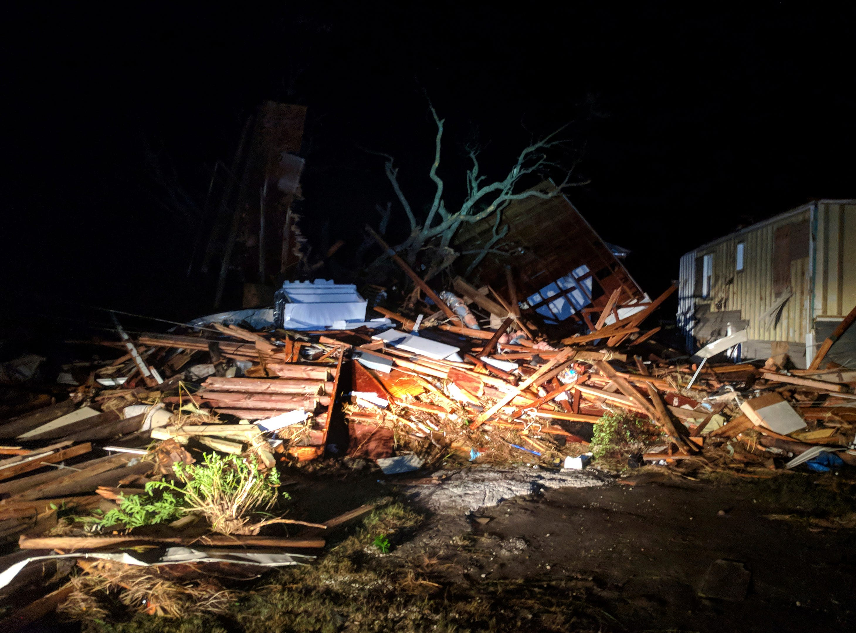 Debris scatters an area in the aftermath of Hurricane Michael in Mexico Beach, Fla., early Thursday, Oct. 11, 2018. (Douglas R. Clifford/Tampa Bay Times via AP)
