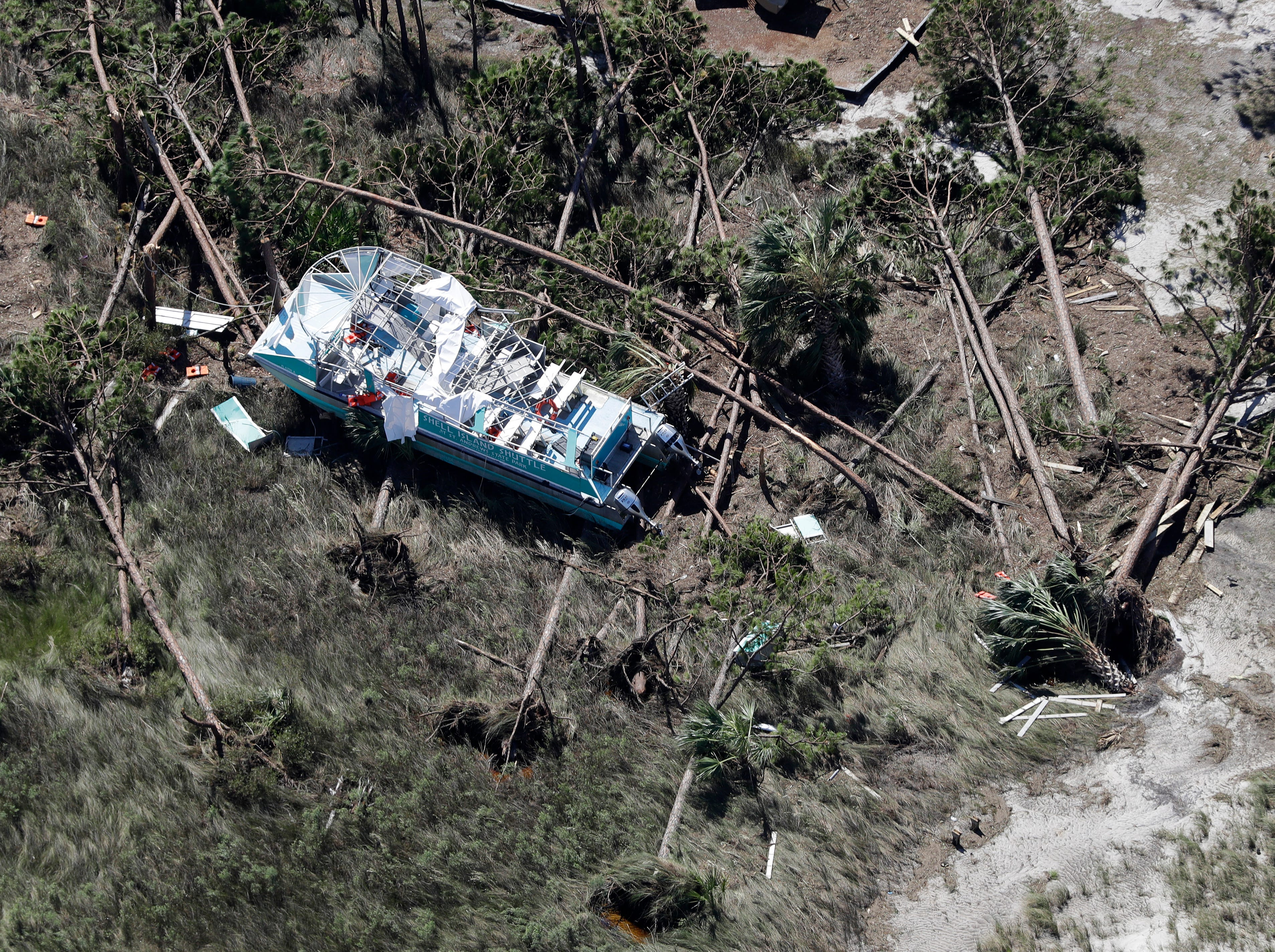 A boat destroyed by Hurricane Michael is shown in this aerial photo Thursday, Oct. 11, 2018, in Mexico Beach, Fla. The devastation inflicted by Hurricane Michael came into focus Thursday with rows upon rows of homes found smashed to pieces, and rescue crews began making their way into the stricken areas in hopes of accounting for hundreds of people who may have stayed behind. (AP Photo/Chris O'Meara)