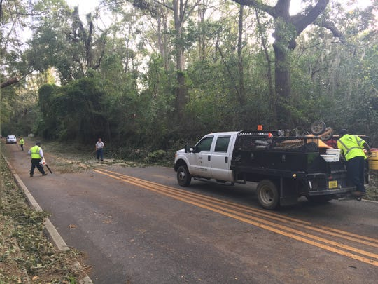 Leon County crew cleans up after Hurricane Michael along Centerville Rd, north of Welaunee Blvd.