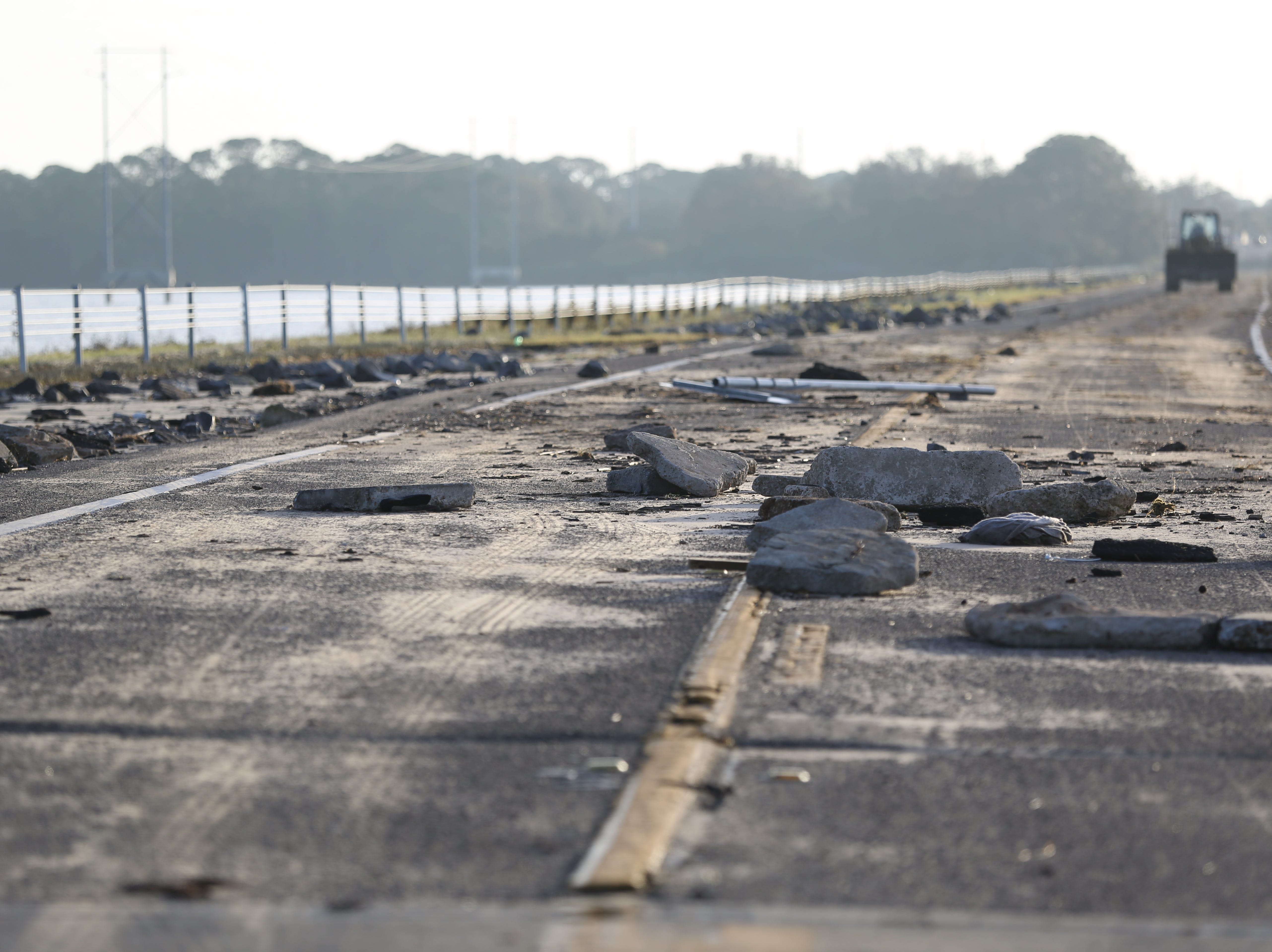 Debris covers the Eastpoint-Apalachicola bridge after Hurricane Michael Thursday, Oct. 11, 2018.