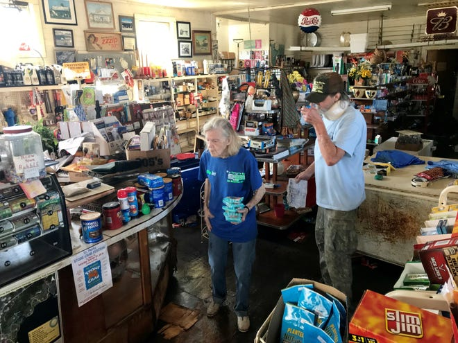 """Joy Brown, known as """"Miss Joy,"""" cleans up at Bo Lynn's Grocery in St. Marks on Thursday, a day after Hurricane Michael sent storm surge into her business."""