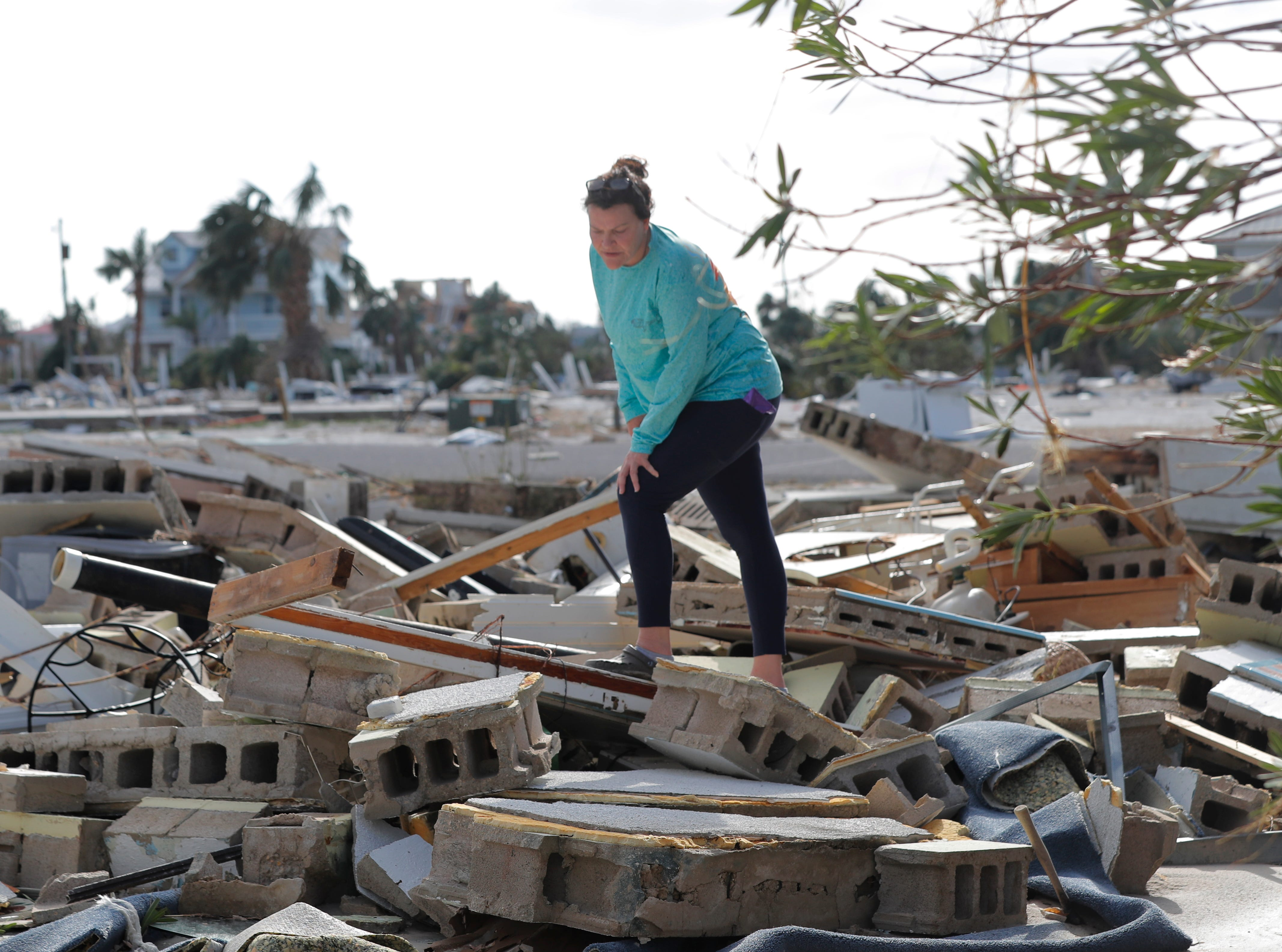Mishelle McPherson looks her friend Agnes Vicari in the rubble of her home, since she knows she stayed behind in the home during Hurricane Michael, in Mexico Beach, Fla., Thursday, Oct. 11, 2018. (AP Photo/Gerald Herbert)