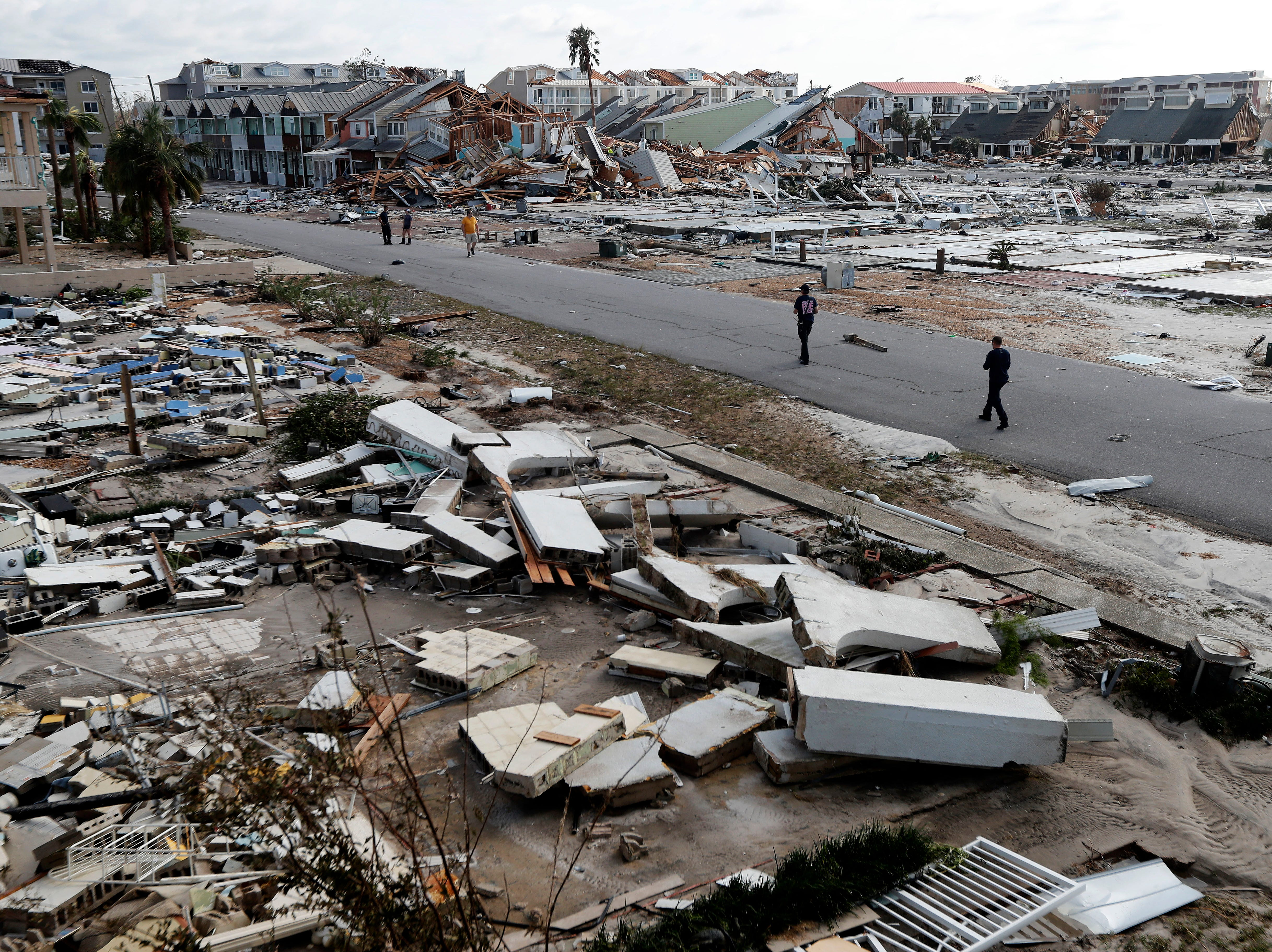 Rescue personnel search amidst debris in the aftermath of Hurricane Michael in Mexico Beach, Fla., Thursday, Oct. 11, 2018. (AP Photo/Gerald Herbert)