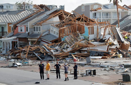 Rescue personnel perform a search in the aftermath of Hurricane Michael in Mexico Beach, Fla., Thursday, Oct. 11, 2018. (AP Photo/Gerald Herbert)