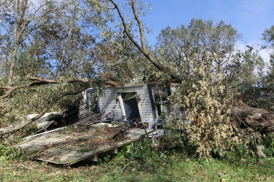 The home off Greensboro Highway in Gretna, Florida, pictured Thursday morning, where 44-year-old Steve Sweet died after a large oak tree crashed onto his home during Hurricane Michael the afternoon of Wednesday, Oct. 10, 2018. His body wasn't retrieved until Thursday evening.