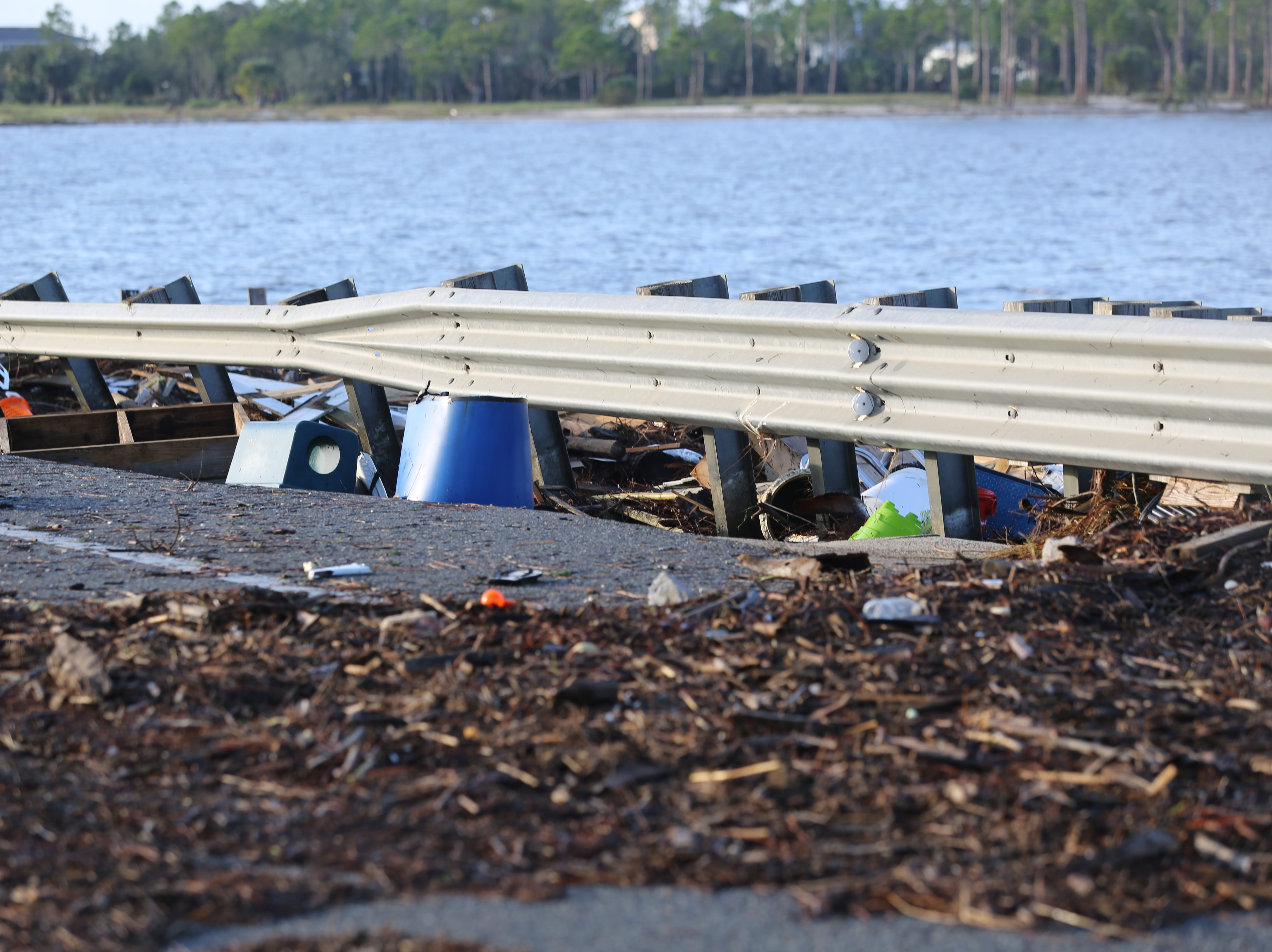 Debris covers the St. George Island bridge after Hurricane Michael Thursday, Oct. 11, 2018.