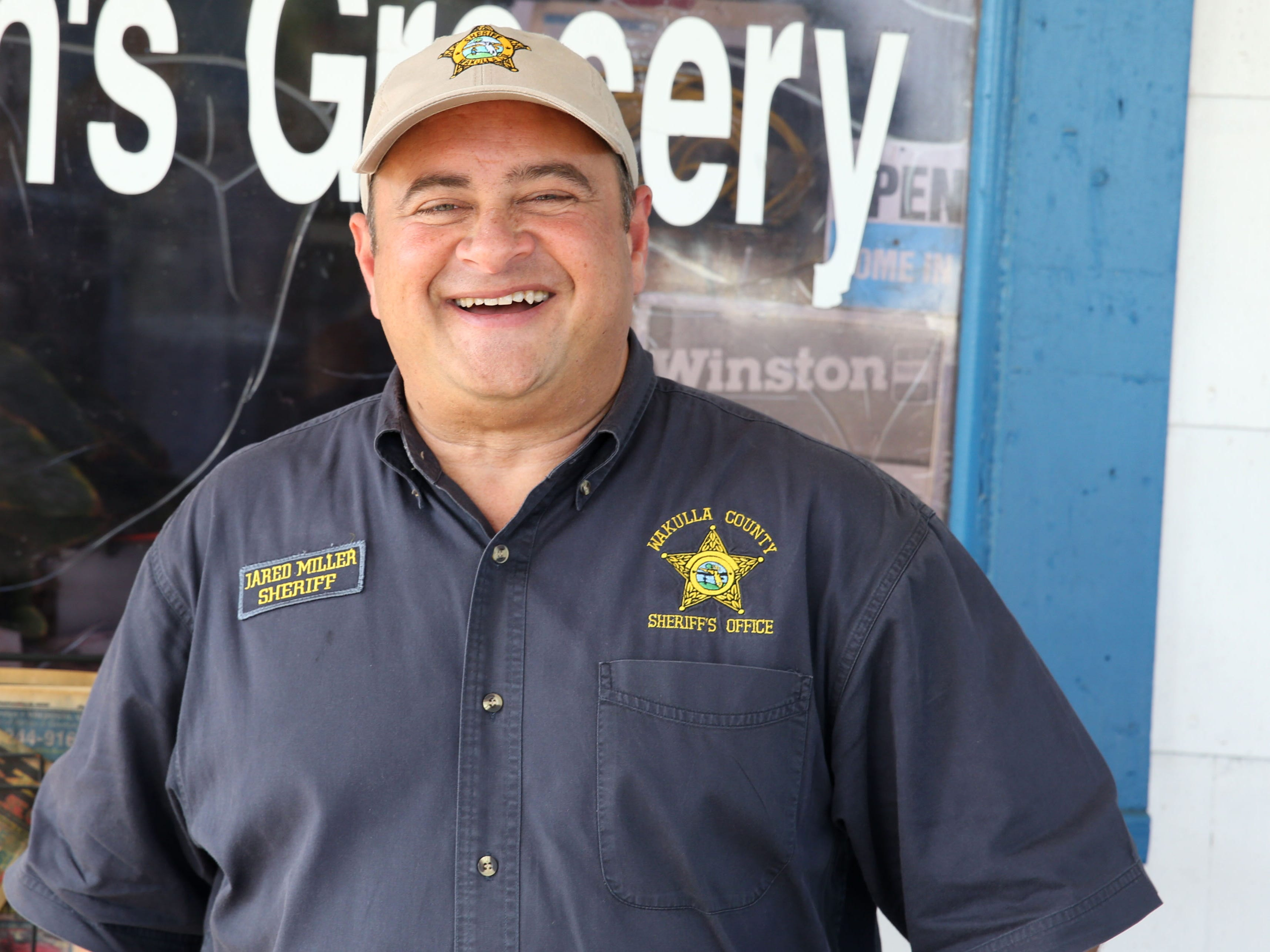 Wakulla County Sheriff, Jared Miller poses for a photo outside of Bo Lynn's Grocery in St. Marks, Fla. on Thursday, Oct. 11, 2018 after Hurricane Michael hits the panhandle.