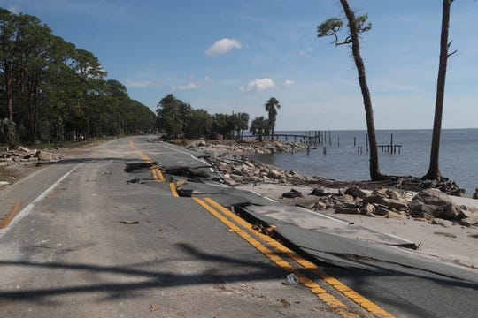 U.S. Highway 98 shows heavy damage during Hurricane Michael Thursday, Oct. 11, 2018.