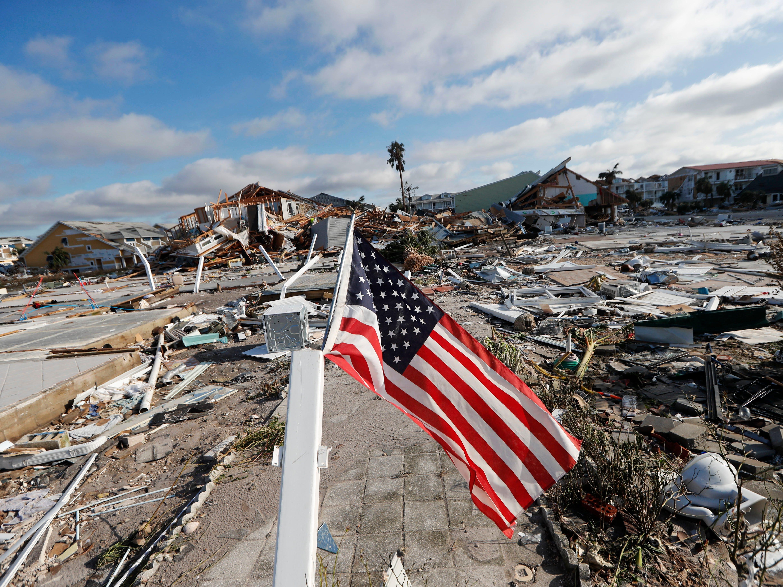 An American flag flies amidst destruction in the aftermath of Hurricane Michael in Mexico Beach, Fla., Thursday, Oct. 11, 2018. (AP Photo/Gerald Herbert)