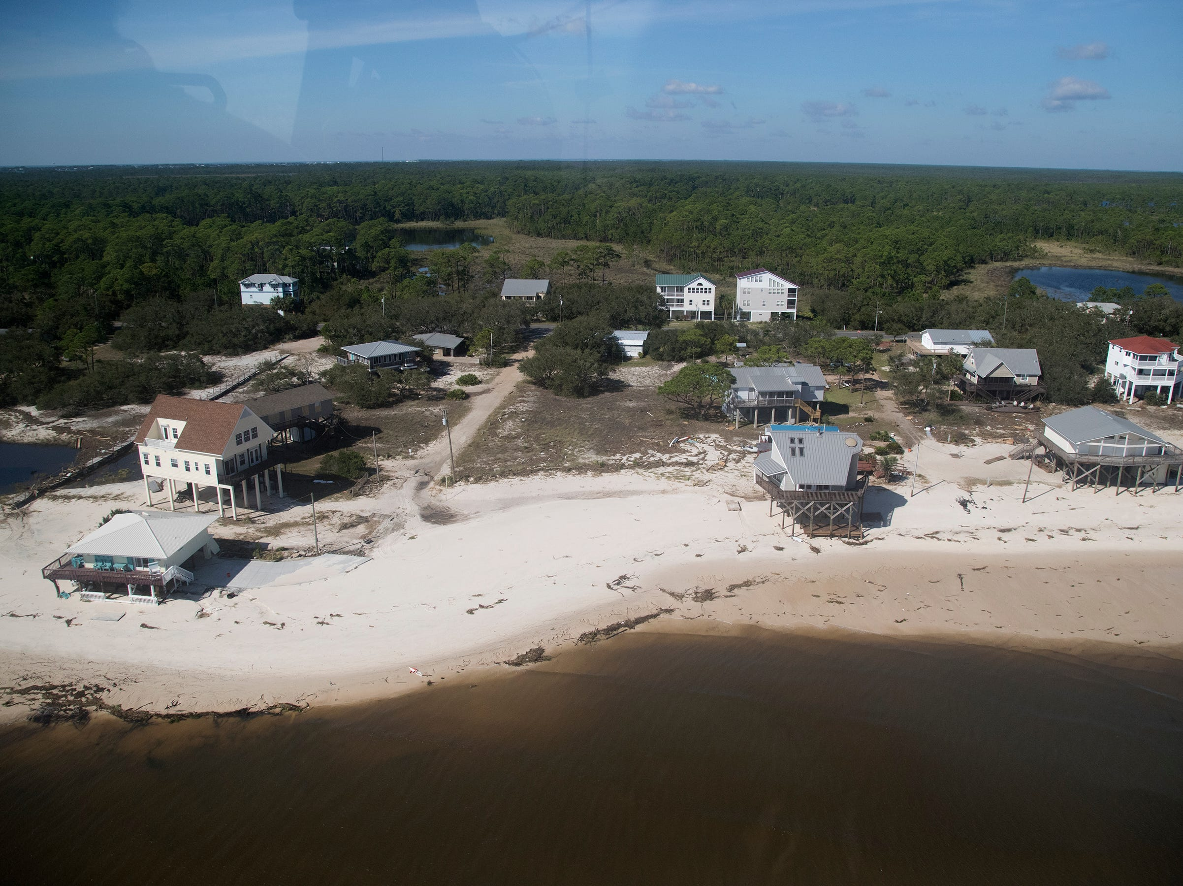 KINFAY MOROTI/THE NEWS-PRESS… Hurricane Michael damaged several homes on Alligator Point in Franklin County, Florida. (Picture date: 10/11/18).