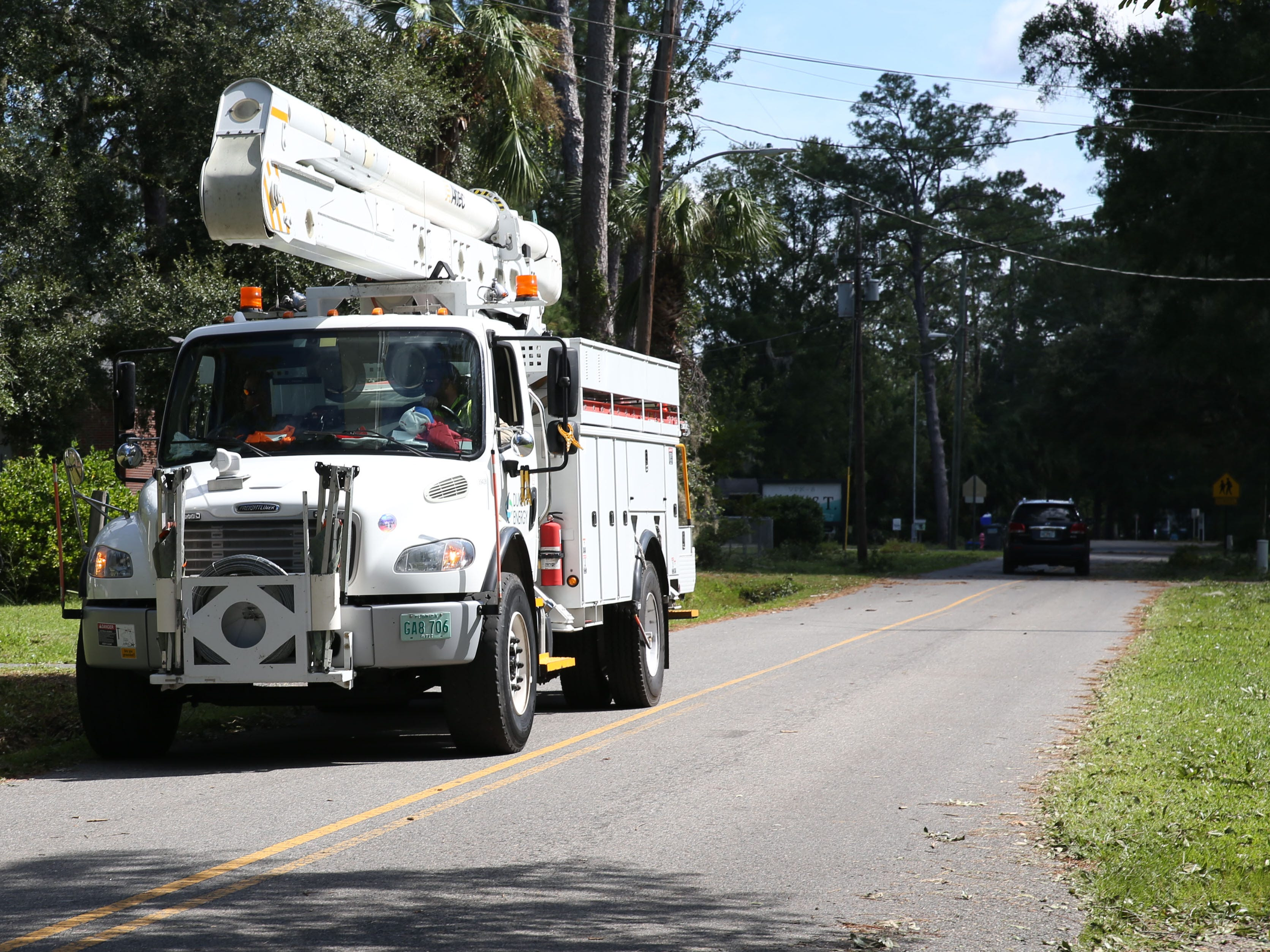 A linemen crew drives through St. Marks, Fla. to restore power after Hurricane Michael on Thursday, Oct. 11, 2018.