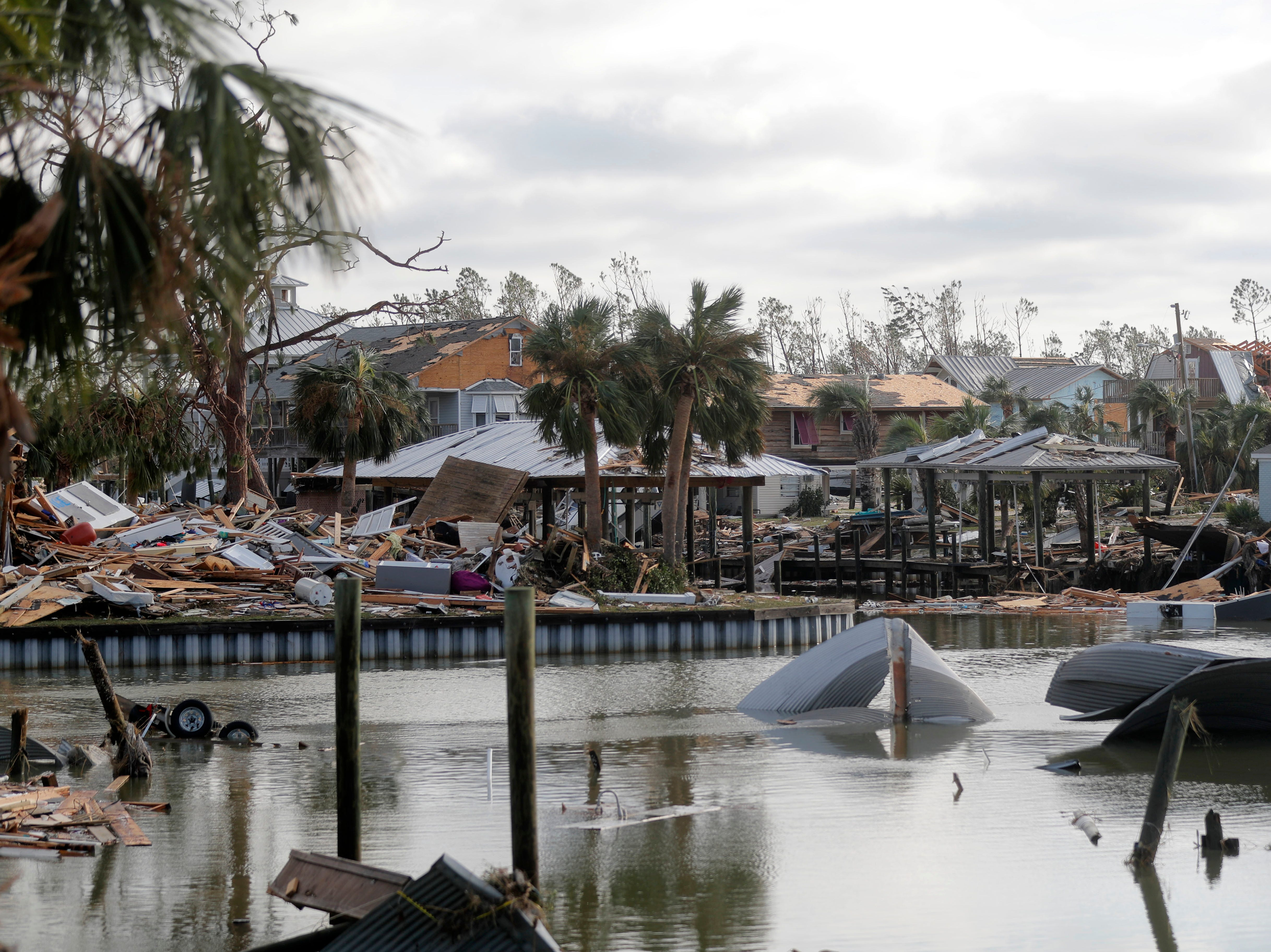 Debris scatters an area in the aftermath of Hurricane Michael in Mexico Beach, Fla., Thursday, Oct. 11, 2018. (AP Photo/Gerald Herbert)