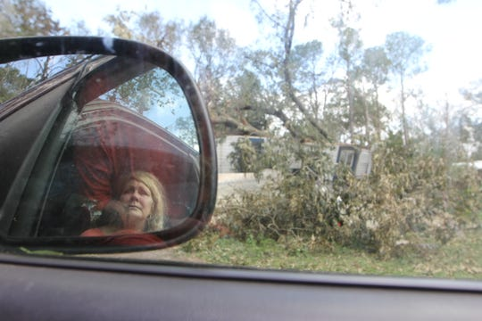 Gayle Sweet, 53, stares at her nearly demolished house in Gretna, Florida, where her husband Steve Sweet died after a tree fell on the house during Hurricane Michael Wednesday, Oct. 10, 2018. His body was still inside the building pinned under the tree until Thursday evening.