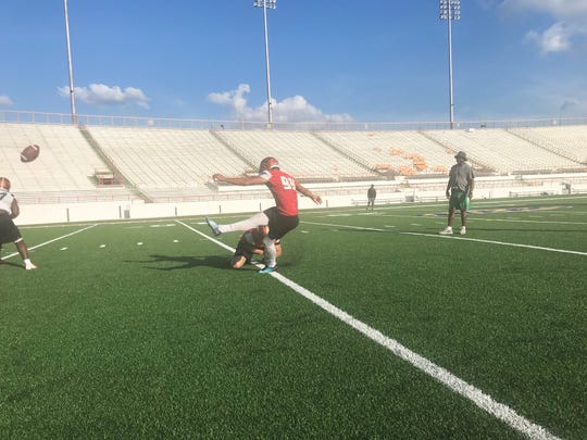 FAMU kicker Yahia Aly hits an extra point in practice.