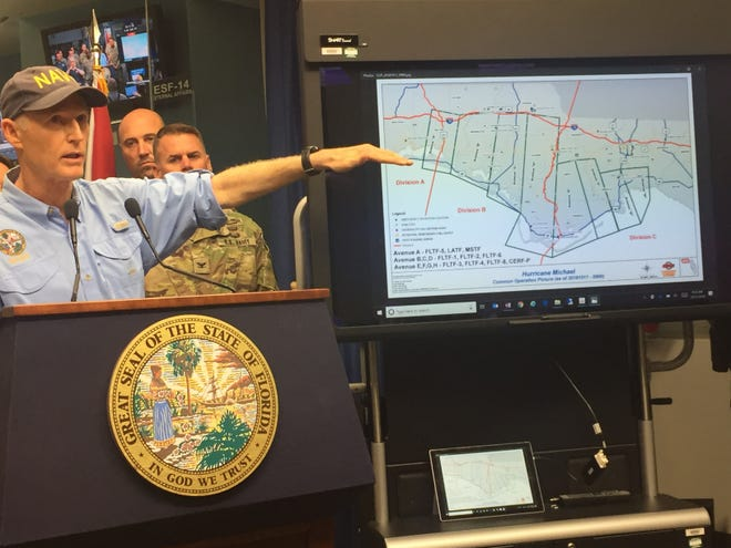Gov. Rick Scott gives a briefing from the state EOC Thursday.