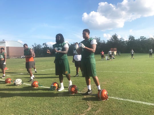 FAMU defensive linemen prep for N.C. A&T. From left to right: Antonio Miller, Elijah Watkins, Demontre Moore and Cameron Burton.