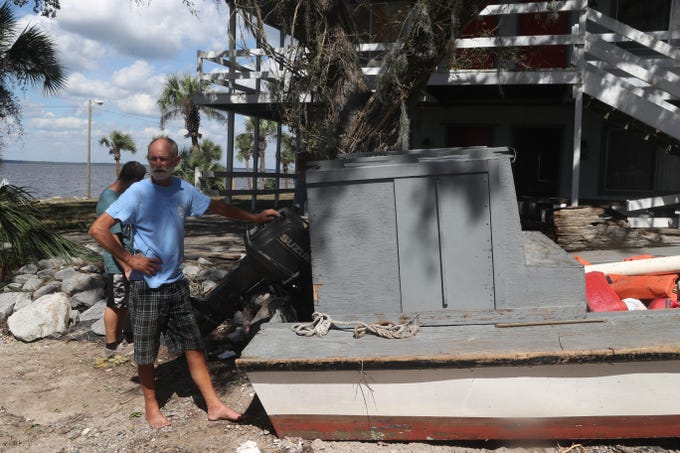 John Cooper biked around Eastpoint, Fla. all day Thursday, Oct. 11, 2018 looking for his boat after Hurricane Michael hit the town Wednesday. He found it washed up among other debris at Sportsman's Lodge.