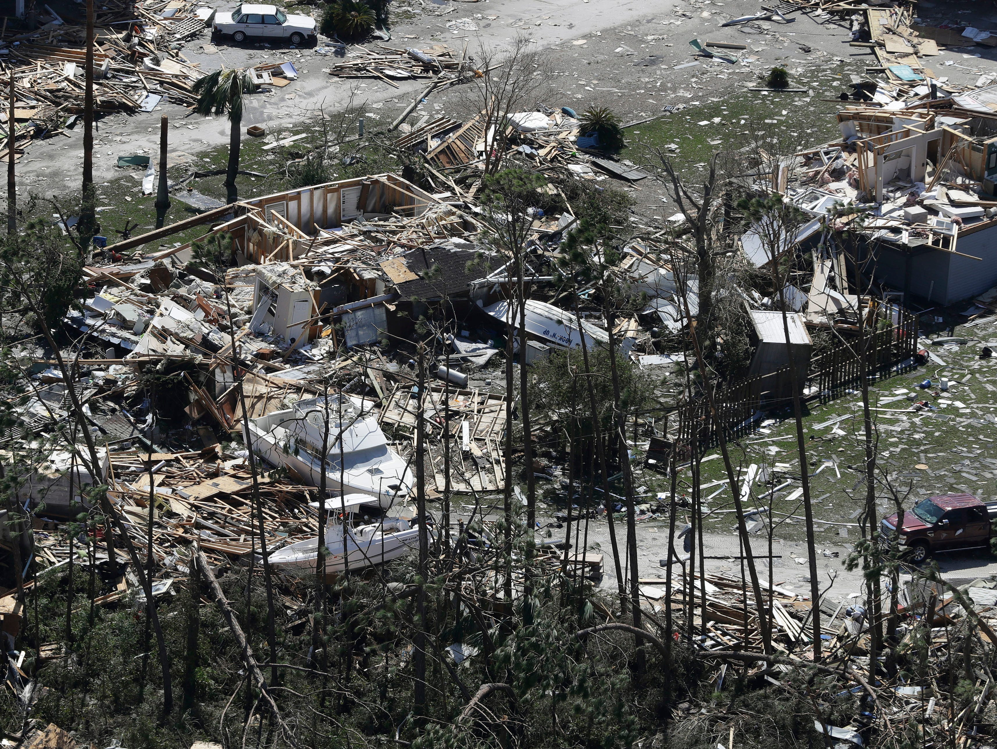 Boats lay among the debris from homes destroyed by Hurricane Michael Thursday, Oct. 11, 2018, in Mexico Beach, Fla. (AP Photo/Chris O'Meara)