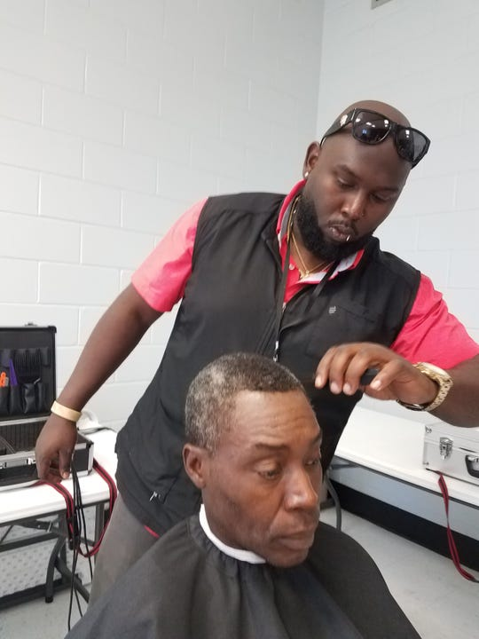 Instructor gives customer a trim.