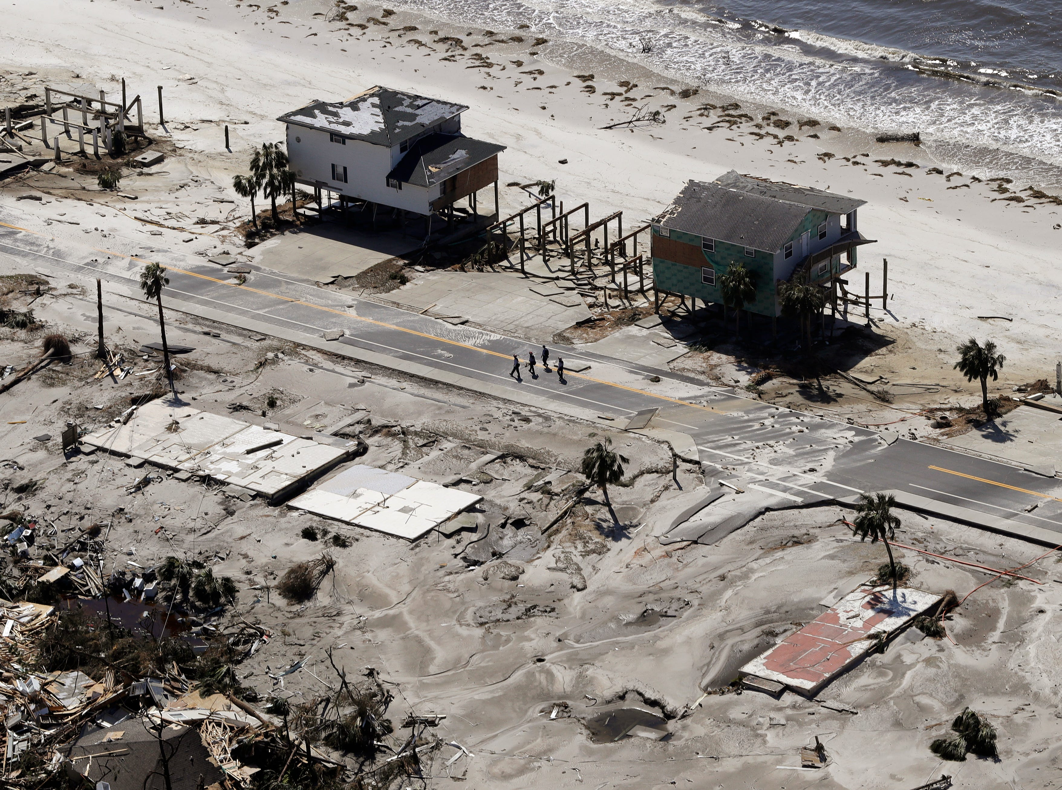 Homes are left swept off their foundations from the effects of Hurricane Michael, Thursday, Oct. 11, 2018, in Mexico Beach, Fla.    Michael made landfall Wednesday as a Category 4 hurricane with 155 mph (250 kph) winds and a storm surge of 9 feet (2.7 meters). (AP Photo/Chris O'Meara)
