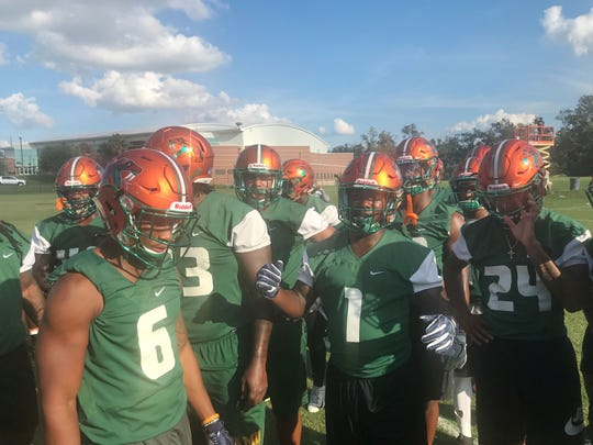 FAMU's defense breaks the huddle during practice. The Rattlers are third in the MEAC in total defense and scoring. They pitched a shutout last week versus Norfolk State.