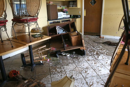 The Sweet Magnolia Inn in St. Marks, Fla. got up to five feet of water from Hurricane Michael. Among the wreckage is an overturned baby grand piano, soaked beds, and toppled over shelves on Thursday, Oct. 11, 2018.