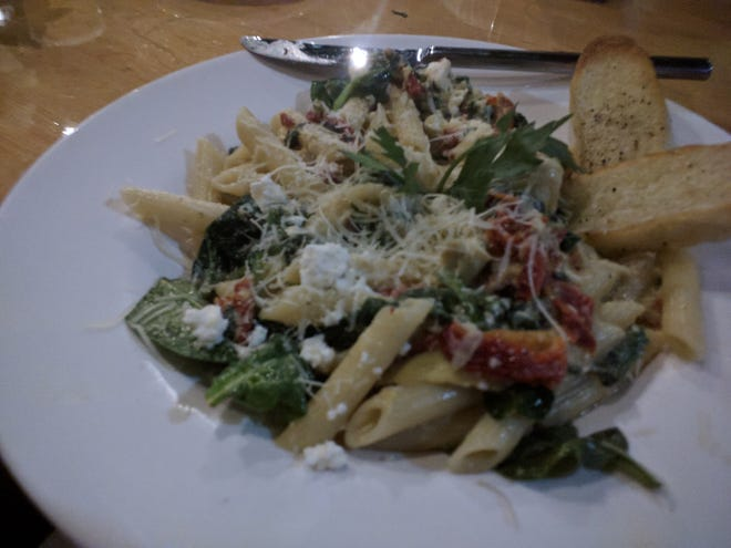 A pasta dish, Corsican, was served with artichokes, spinach, garlic, sun-dried tomatoesand feta cheese mixed in with penne at American Grill and Bar in Vero Beach.