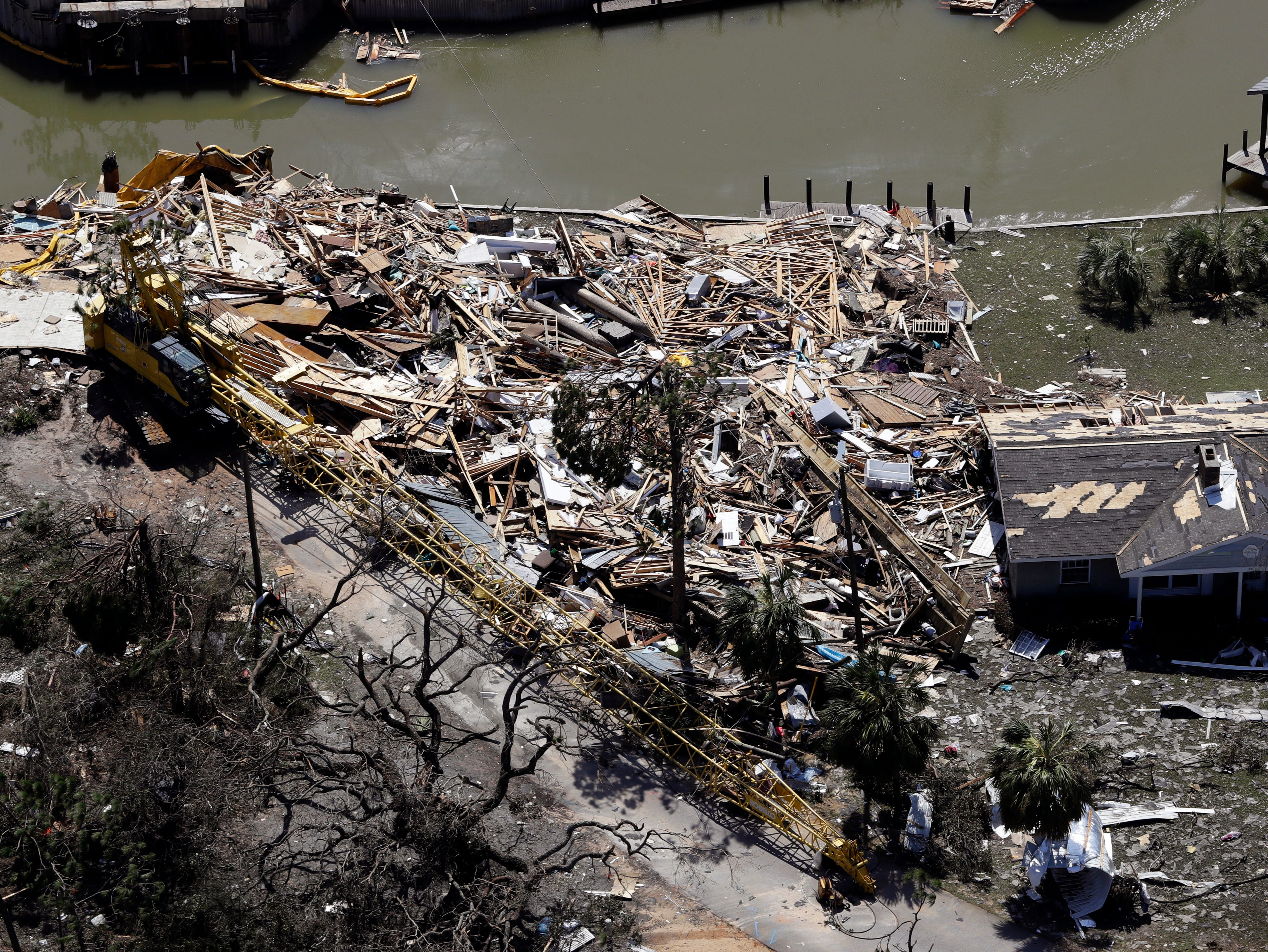 Debris from Hurricane Michael fills a lot Thursday, Oct. 11, 2018, in Mexico Beach, Fla. Hurricane Michael made landfall Wednesday as a Category 4 hurricane with 155 mph (250 kph) winds and a storm surge of 9 feet (2.7 meters). (AP Photo/Chris O'Meara)