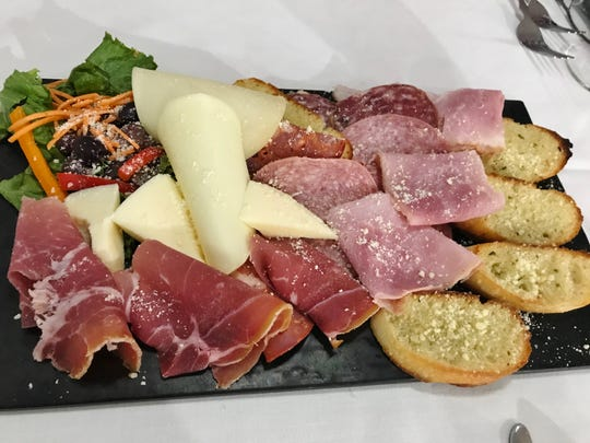 Corleone's Antipasto Giro D'Italia had fresh thin slices of Mortadella, Prosciutto, Ham, Salami, Provolone and chunks of lovely Piave Cheese alongside garlic crostini.