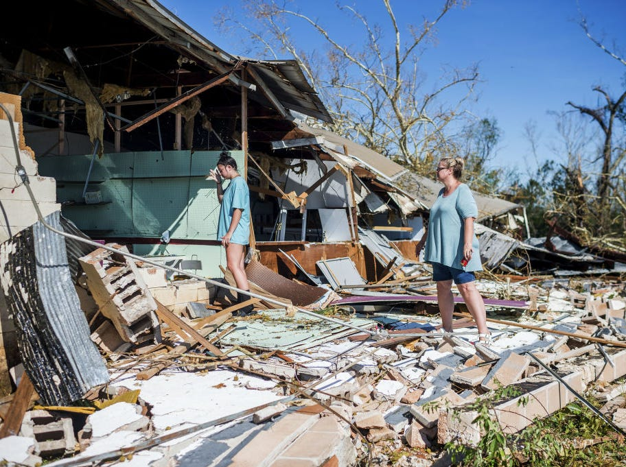 The Slaughter family saves their merchandise from their antique store inside the collapsed 15th Street Flea Market in Panama City, Florida after Hurricane Michael on October 11, 2018. - Residents of the Florida Panhandle woke to scenes of devastation Thursday after Michael tore a path through the coastal region as a powerful hurricane that killed at least two people. (Photo by Emily KASK / AFP)        (Photo credit should read EMILY KASK/AFP/Getty Images)