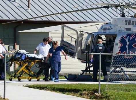 A patient is loaded into a medical helicopter at Gulf Coast Regional Medical Center in Panama City. Patients are being transferred to other hospitals due to the hospital being on generator power.