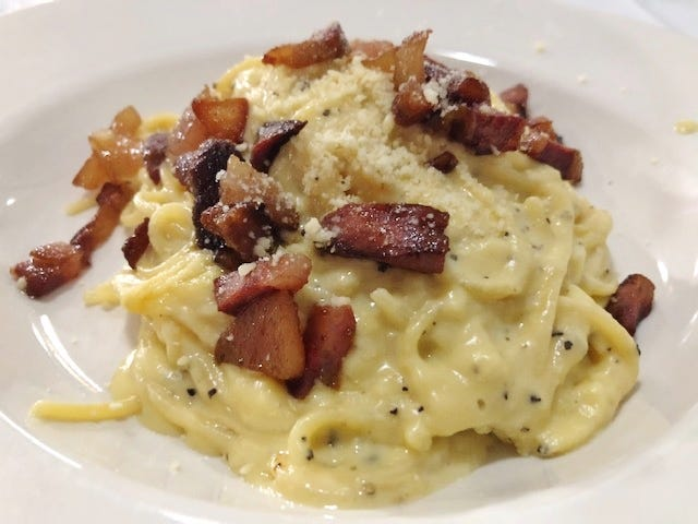Corleone's Spaghetti Alla Carbonara  was pasta served in a creamy sauce made with eggs, Romano and Parmesan cheeses and topped with sautéed pork cheek.