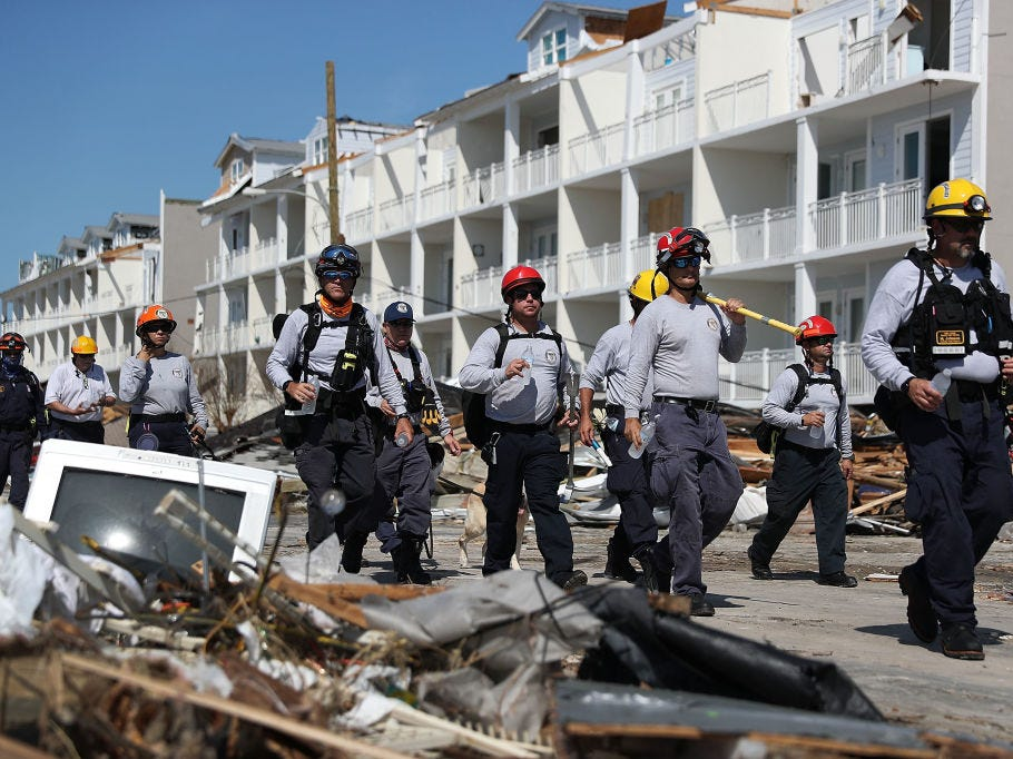 MEXICO BEACH, FL - OCTOBER 11:  Members of the South Florida Search and Rescue team search for survivors in the destruction left after Hurricane Michael passed through the area on October 11, 2018 in Mexico Beach, Florida.  The hurricane hit the panhandle area with category 4 winds causing major damage.  (Photo by Joe Raedle/Getty Images)