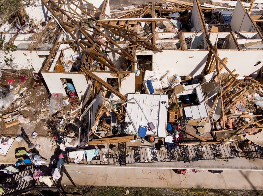 A man works though the remains of an apartment in the aftermath of Hurricane Michael October 11, 2018 in Panama City, Florida. - Residents of the Florida Panhandle woke to scenes of devastation Thursday after Michael tore a path through the coastal region as a powerful hurricane that killed at least two people. (Photo by Brendan Smialowski / AFP)        (Photo credit should read BRENDAN SMIALOWSKI/AFP/Getty Images)