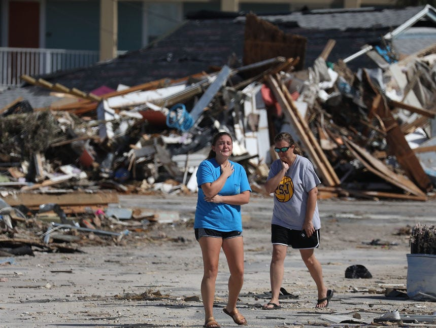 MEXICO BEACH, FL - OCTOBER 11:  Elizabeth Hanson (R) and her daughter,  become emotional as they look at their home that was heavily damaged when Michael passed through the area on October 11, 2018 in Mexico Beach, Florida.  The hurricane hit the panhandle area with category 4 winds causing major damage.  (Photo by Joe Raedle/Getty Images)