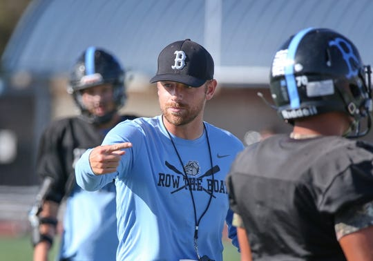 Buena High head coach Ryan Bolland  has some instructions for his team during Wednesday's practice.