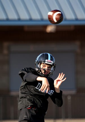 Buena High quarterback Owen Medina fires a pass during Wednesday's practice. Medina is part of a young and improving Bulldogs offense.