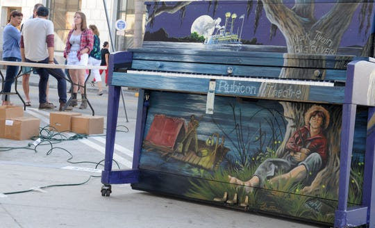 """At the corner of California and Main streets, the Mark Twain """"Big River"""" piano beckons players. The Rubicon Theatre is celebrating the company's 20th season with an installation of painted pianos in downtown Ventura. The instruments are available for anyone's use."""