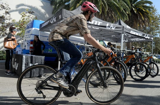 Tobias Smith takes an E-Bike for a spin. National Bike to Work Week rides into Ventura County this week.