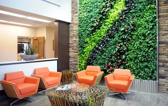 The building's Living Green Wall is made up of 672 potted plants that are watered with an automated drip irrigation system and designed to improve air quality at the new facility.