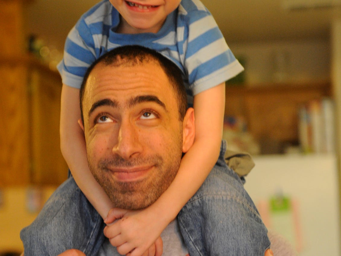 Oliver Ajluni, 3, smiles with his father David Ajluni, 32, in their Visalia home. The boy has battled Langerhan Cell Histiocytosis, a rare cancer/autoimmune hybrid disease for two years. He is currently in remission, but suffers seizures due to the chemotherapy treatment that saved his life.
